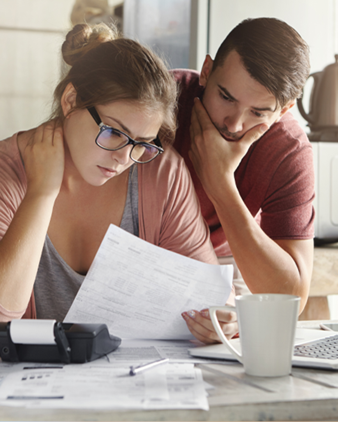 Two people look at paper with concern